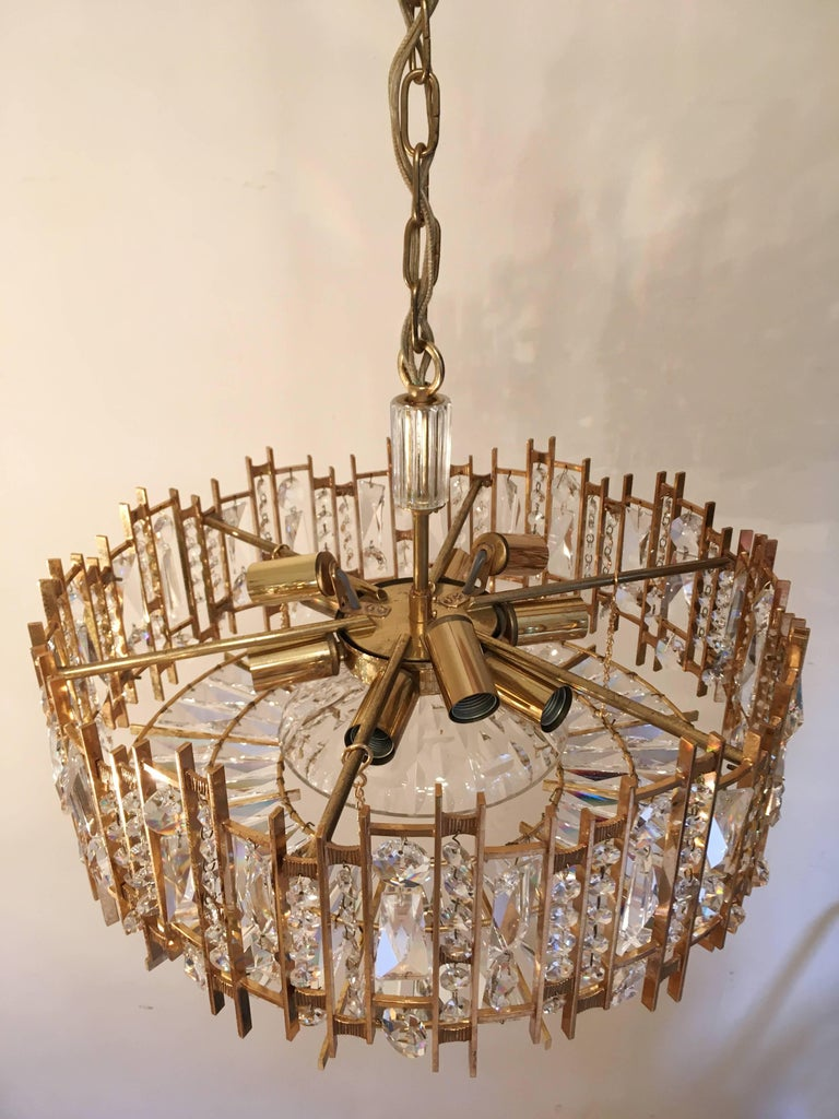 A Fine gold-plated chandelier made by Palwa (Palme and Walter), Germany, circa 1960  This light was designed and handcrafted with superb attention to detail. The brass framework is gold plated with hundreds of high quality lead-cut crystals
