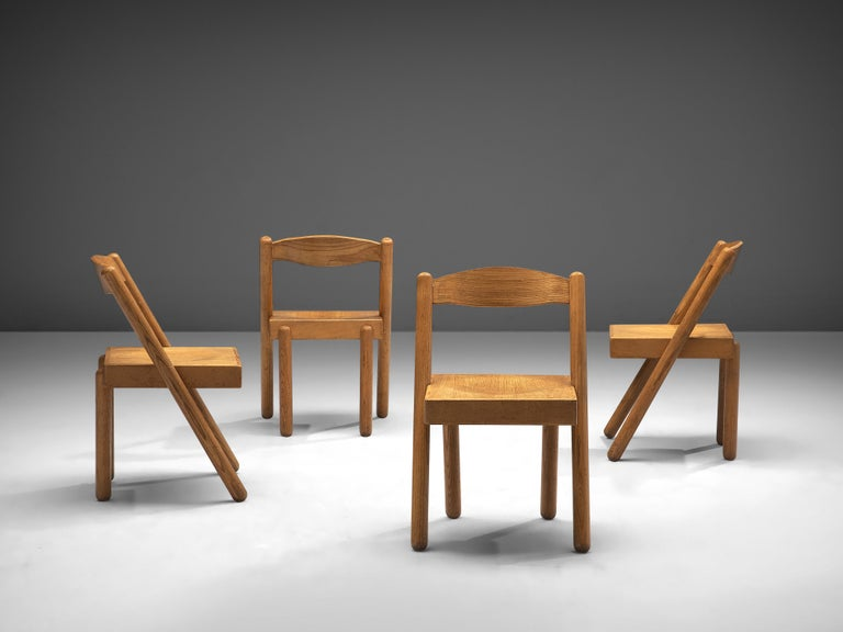 Roberto Pamio and Renato Toso, set of four dining chairs model 'Iva', patinated ash, Italy, 1960s  This Italian set of 4 dining chairs was designed by Roberto Pamio and Renato Toso in the 1960s. The chair model 'Iva' is characterized by its