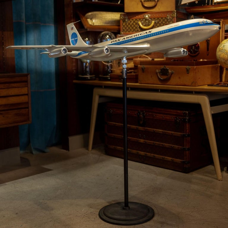 An exceptional large scale vintage fiberglass and resin composite promotional model of a Boeing 707 in Pan Am's iconic livery on original steel and cast iron floor stand with ball and socket mount so the plane's position can be adjusted as desired,