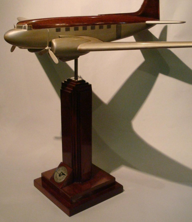 Art Deco / midcentury large DC3 desk aviation model. Pan-Am wooden airplane model. It was in an office of the company in South America. Very good restored conditions. Slight age wear.  History Pan American Airways began the first transatlantic