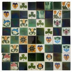 Panel of 16 Authentic Glazed Art Deco Relief Tiles, circa 1930s