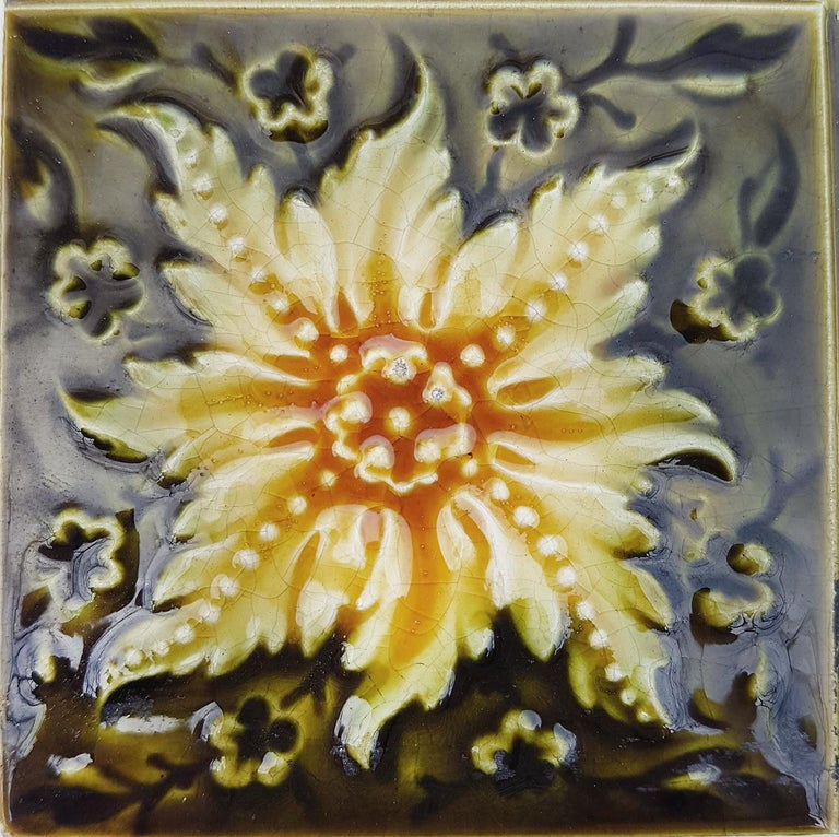 Recently lifted from its original home, a unique and antique set of Art Deco handmade tiles by S.a. Des Pavillions, Florennes. A beautiful relief and color. With stylized design. These tiles would be charming displayed on easels, framed or