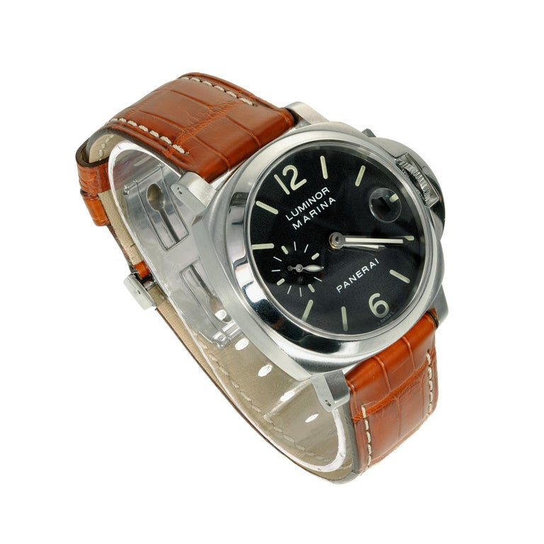 Panerai luminore marina Pam00048. Self-winding automatic mens wristwatch 40mm Steel case. Alligator band with original Panerai steel buckle. The movement is Panerai OP 111 with 21 jewels small seconds at 9 o'clock and the date at 3 o'clock. The