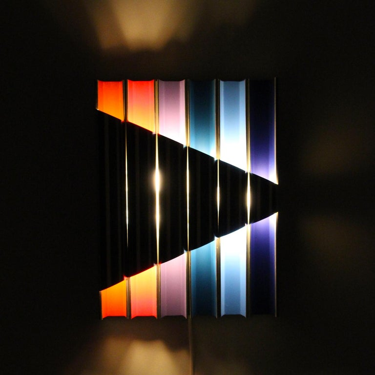Panflute- extremely rare light relief designed by Bent Karlby in 1968 and produced by Lyfa - gorgeous aluminum wall lamp with six different inner coating - in good vintage condition.  ThePanflute is comprised of six narrow aluminum 'panpipes'