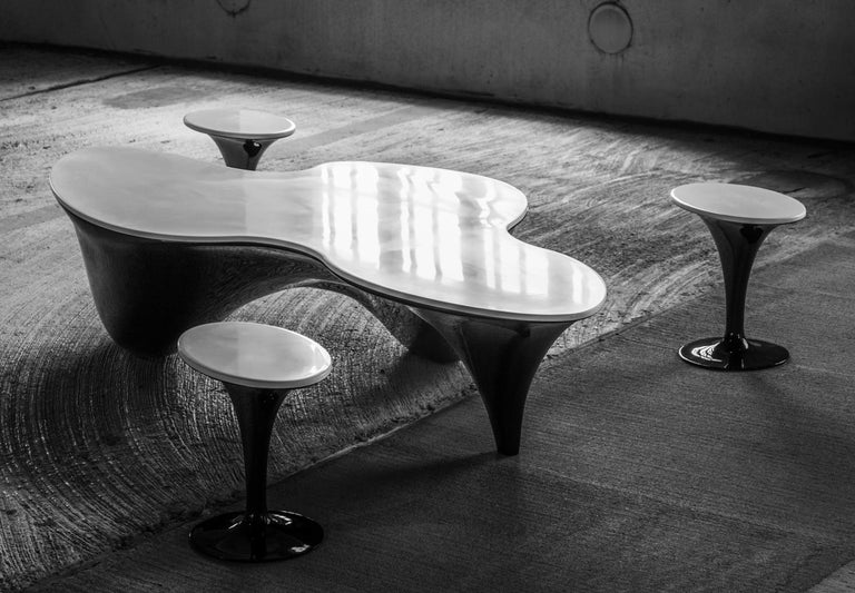 Pangaea is a multi-part coffee table inspired by abstract and surrealist forms. Three movable side tables can be nested into the main table or stand independently throughout a room. The table is composed of fiberglass and composite acrylic (Corian)