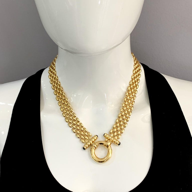 A beautifully made cornerstone piece in 14 karat yellow gold, this fabulous five-row panther chain has bar ends tipped with onyx cabochons and an oversized bolt ring closure that can be worn front or back:  as versatile as it is