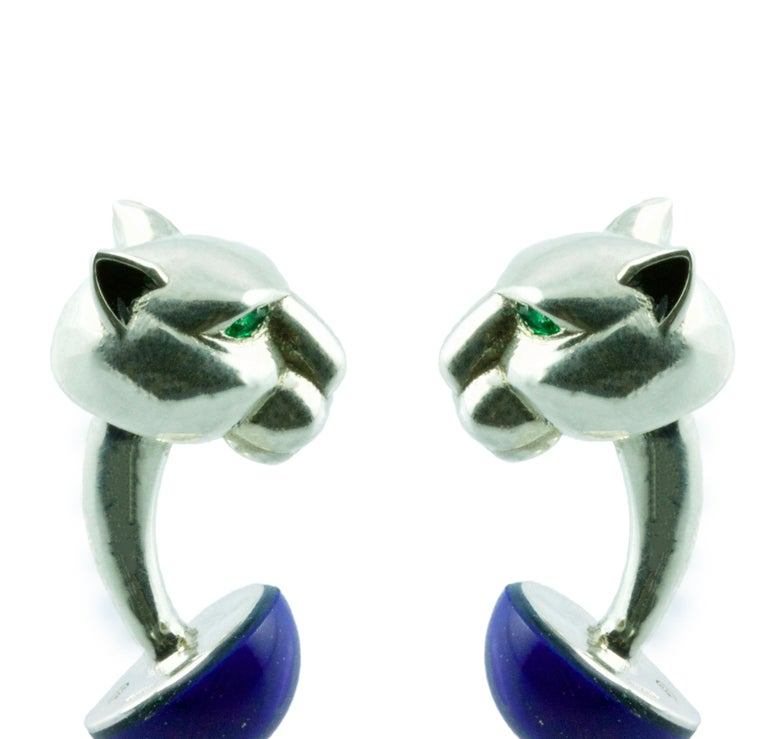 Silver 925 panther cufflinks embellished by emeralds on his eyes and a half sphere in lapis lazuli, ears with black enamel.