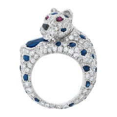 Panthere De Cartier 2.90 Carat Oval Sapphire, Diamond and Ruby Ring in Platinum