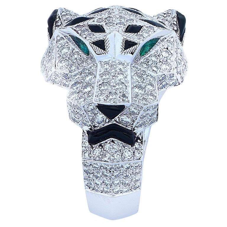 Stunning Panthere de Cartier ring, crafted in 18 karat white gold, encrusted with 365 diamonds weighing 2.55 carats total weight, with emerald eyes and an onyx nose and accents. The ring, which features Cartier's iconic panther, is a European size