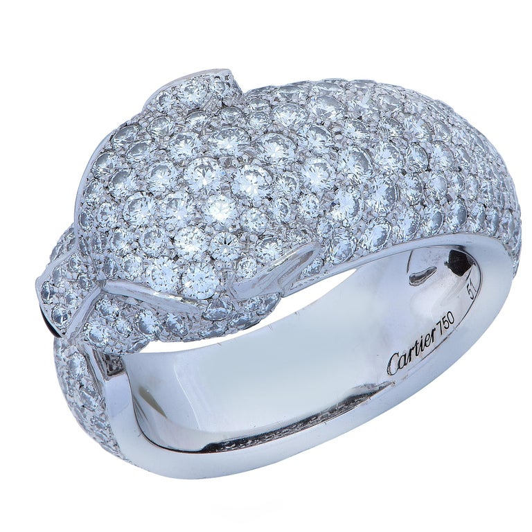 Stunning Panthere de Cartier diamond ring, crafted in 18 karat white gold, encrusted with 285 diamonds weighing 2.39 carats total weight, with emerald eyes and an onyx nose. The ring, which features Cartier's iconic panther, is a European size 51,