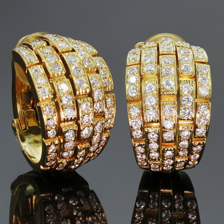 These classic Cartier wrap earrings from the iconic Panthère De Cartier collection feature 5 rows of rectangular links crafted in 18k yellow gold and set with brilliant-cut round diamonds of an estimated 2.00 carats. Made in France circa 2000s.