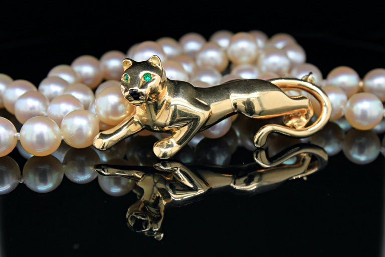 A tsavorite and onyx full body gold panther necklace with akoya pearls, by Cartier from the Panthere de Cartier collection. This collection is an iconic and timeless Cartier style collection that resonates both elegance and fierceness.   In this