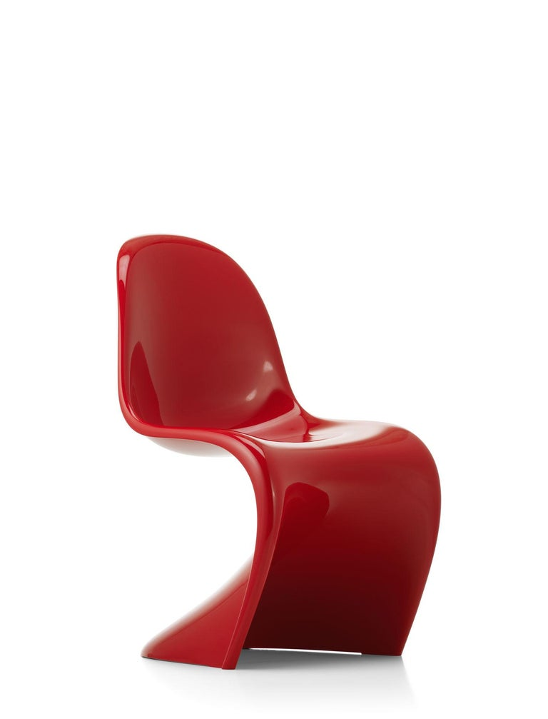 Chair designed by Verner Panton in 1959. Manufactured by Vitra, Switzerland.  Having conceived a design for an all-plastic chair made from one piece, it took Verner Panton several years to find a manufacturer. He first came into contact with