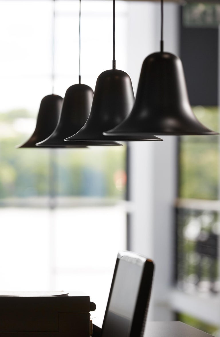 Pendant distinguished by a bell-like, widely flaring shade which is mounted with the aperture facing down. Incl. ceiling canopy.    Material:   Shade and ceiling canopy is made of metal (copper-plated)    Light source:   E26 (110V) max. 60W    Cord: