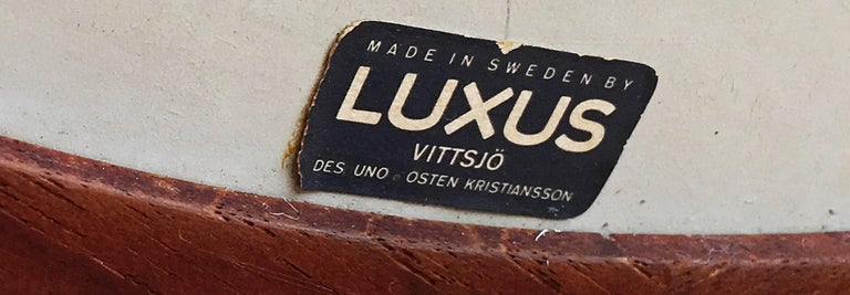 Swedish Pao Ferro and Stainless Steel Mirror by Uno and Osten Kristiansson for Luxus For Sale