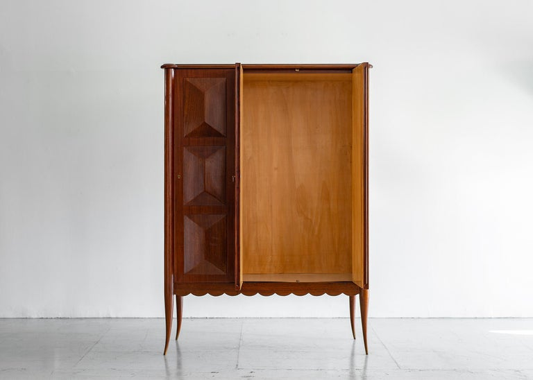 Gorgeous Paolo Buffa cabinet, circa 1940s. Rare 1940s cabinet with scalloped edge detail and horn legs. Cabinet opens with 2 doors -revealing beautiful wood inside. Shelves can be any height. Mahogany wood with original finish.