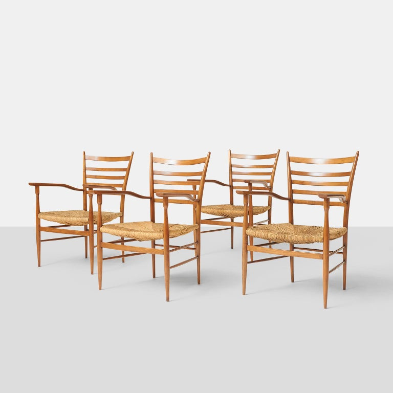 Paolo Buffa chiavarine armchairs A group of 4 chiavarine armchairs with hand woven rush seats and a ladder back and manufactured in cherry wood. Stamped with the makers mark. Italy, circa 1950s.