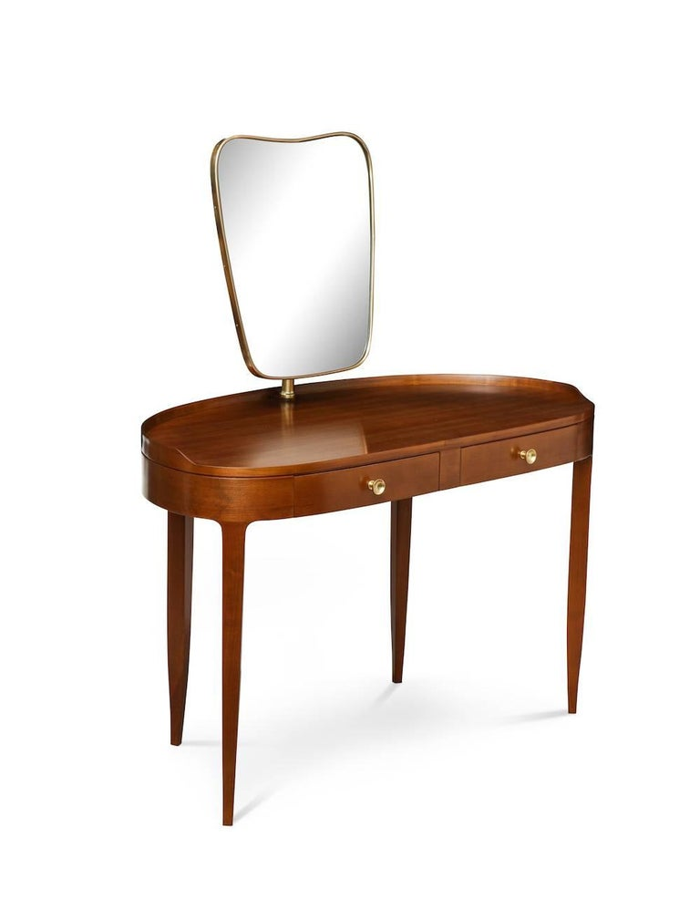 Rare dressing table by Paolo Buffa. Sexy two-drawer table in cherrywood. Lozenge-shaped top, with gallery edge and tapering legs. Brass circular pulls and brass mount for mirror which pivots forward and back. An outstanding example of Buffa's design