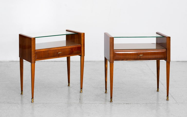 Exquisite pair of Italian nightstands by Paolo Buffa  Original floating glass top.   Brass hardware and feet with tapered legs.