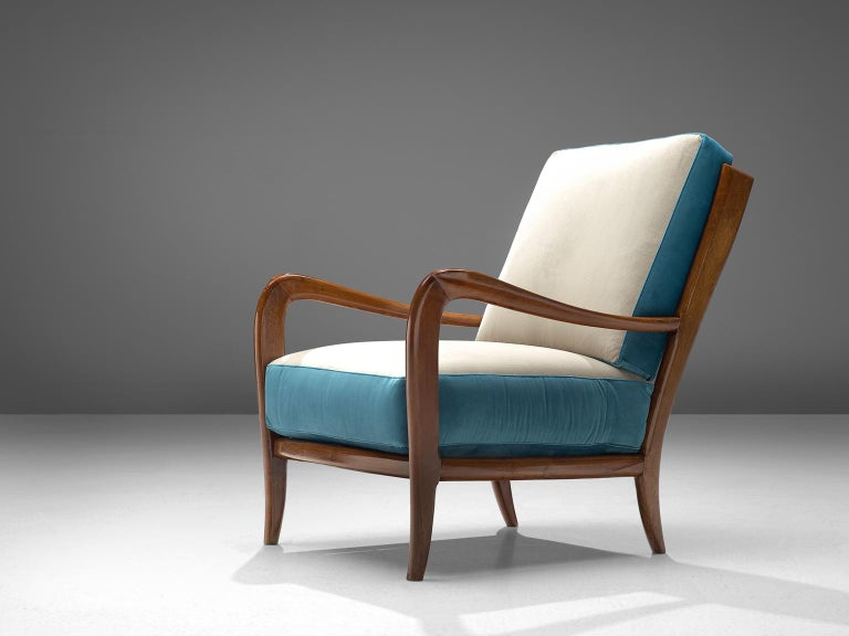Armchair, Italian walnut and fabric, 1960s, Italy.  This poetic armchair is made in the style of Paolo Buffa (1903-1970). The chairs are luxurious in their look and feel and thanks to their slightly tilted back, extremely comfortable. The grains in