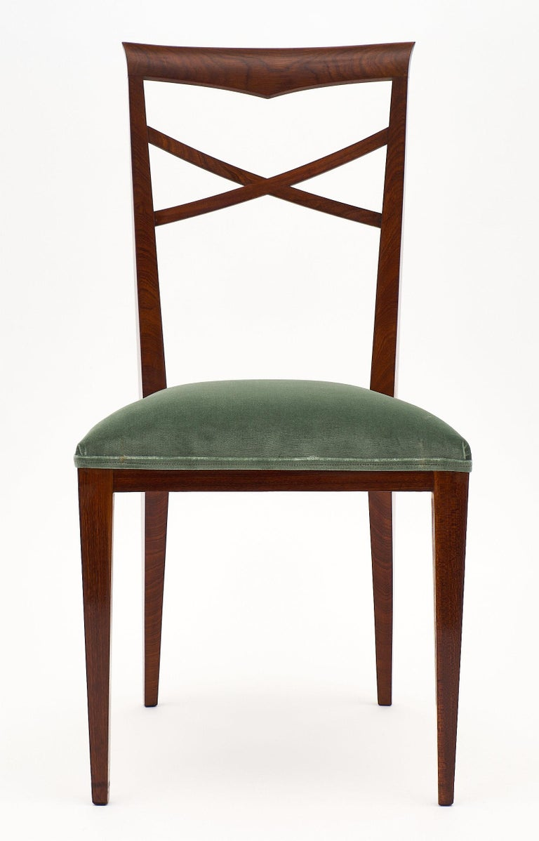 An elegant and refined set of Italian Paolo Buffa style dinning chairs mad of solid walnut finished with a French polish. We love the clean design reminiscent of Buffa, and the strength and comfort of the chairs. The design brings lightness to a