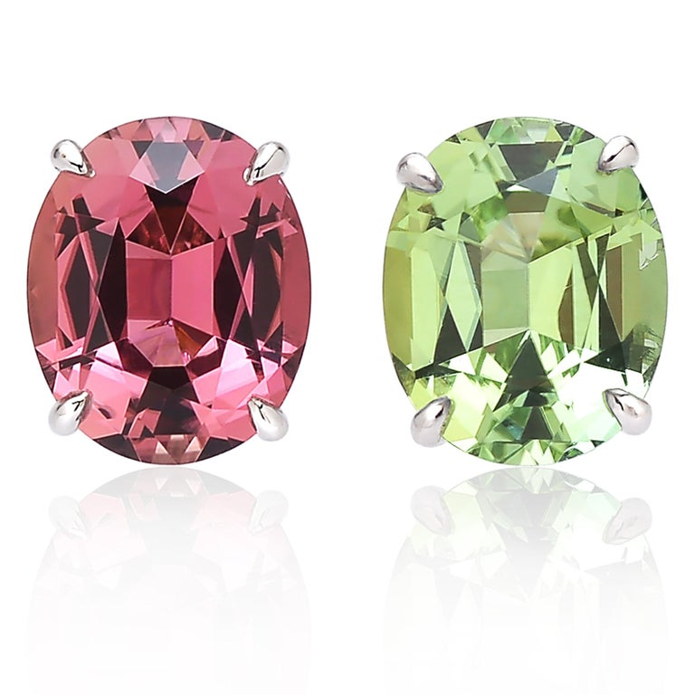 One of a kind oval-cut pink and mint tourmaline stud earrings set in 18 karat white gold.   A truly unique alternative to a classic pair of diamond studs, these 18 karat white gold studs are certainly a great addition to anyone's jewelry collection.
