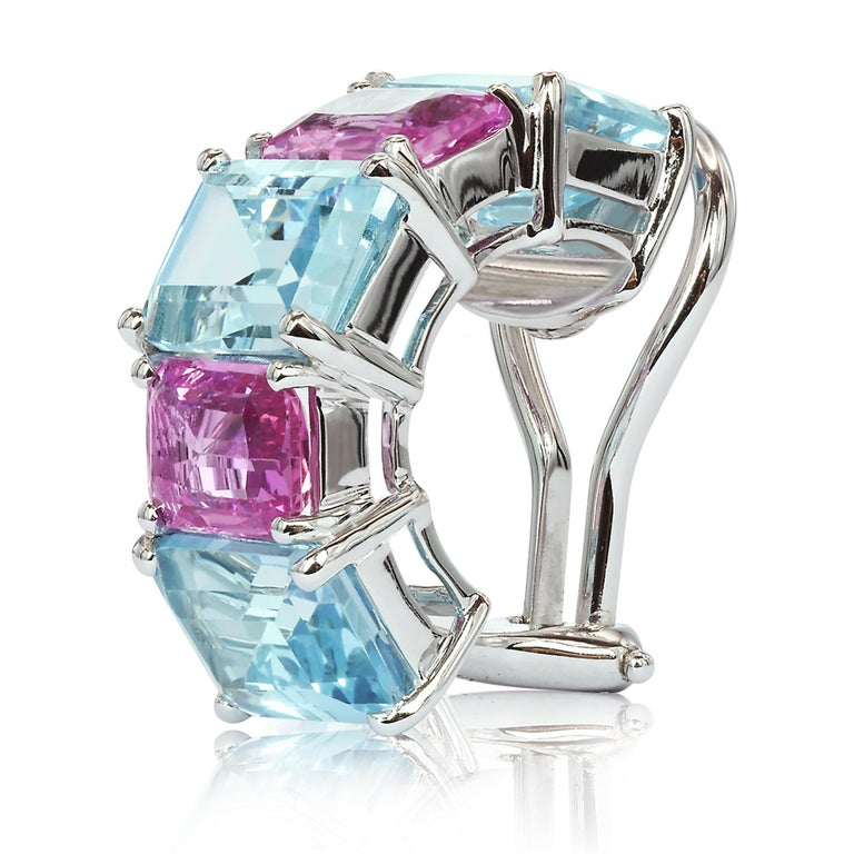 18 karat white gold Florentine earrings set with emerald-cut blue topaz and pink sapphires.   Inspired by the Garden of the Iris, the Florentine collection pairs bold color combinations of geometric gemstones to translate Paolo Costagli's memories