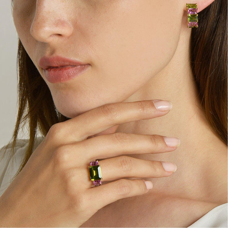 18 karat yellow gold Florentine earrings set with emerald-cut peridots and pink sapphires.   Inspired by the Garden of Iris, the Florentine collection pairs bold color combinations of geometric gemstones to translate Paolo Costagli's memories of