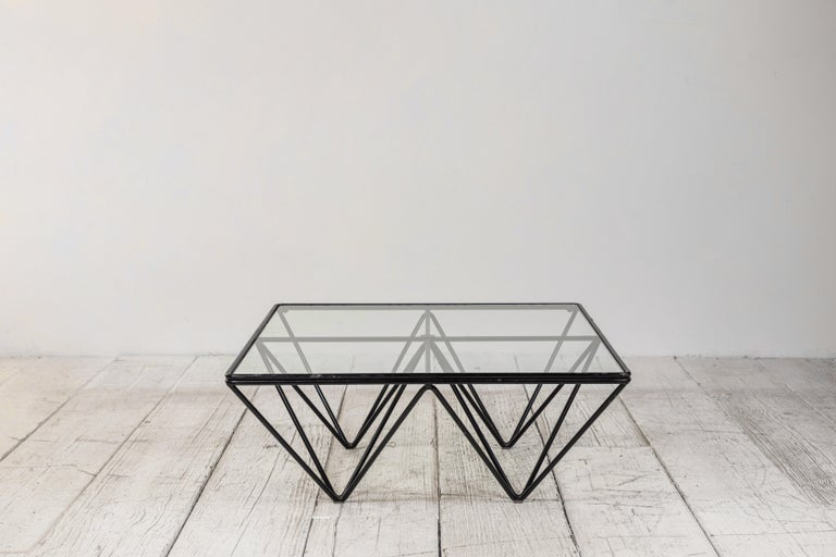 Iconic wire framed and glass topped 'Alanda' coffee table by designer Paolo Piva for B&B Italia, 1981. Black enameled wire metal frame with clear glass top. In original condition with visible signs of wear consistent with age and usage.