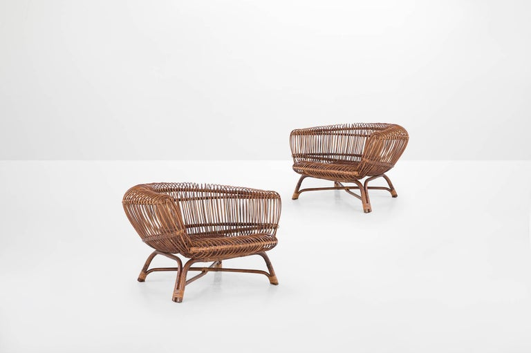"""Paolo Tilche (1925-2000)  Pair of armchairs model """"Silvia"""" Manufactured by Arform,  Italy, 1956 Rattan Pair of Italian 20th century ratan armchairs Model """"Silvia""""  Measurements 100 cm x 100 cm x 63 cm 39.37 in x 39.37 in x 24.8"""