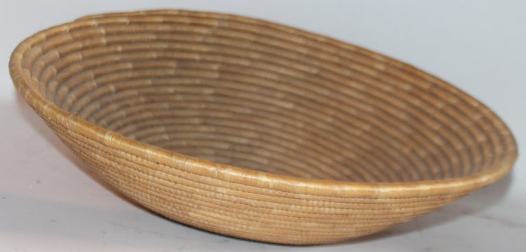 At tallest point the basket measure 8 inches and diameter measures 22 inches. The condition is very good and it is a very large size basket.