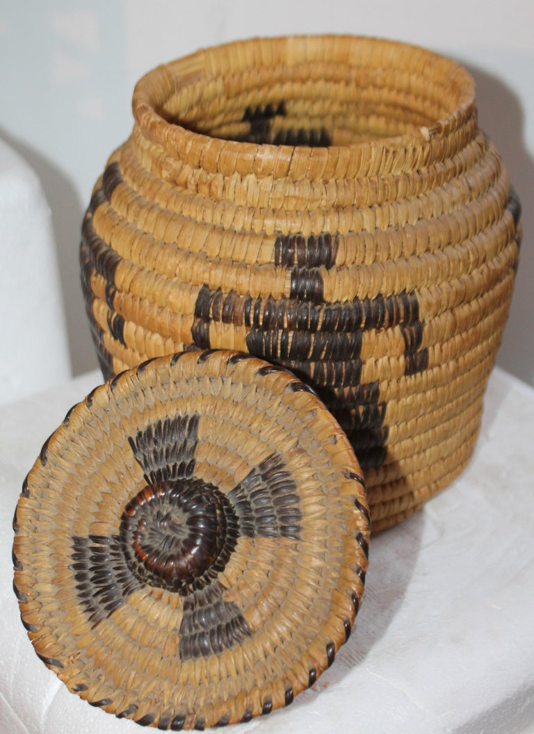 This fine American Indian Papago lidded basket in good condition and quite unusual dancers featured on the basket.