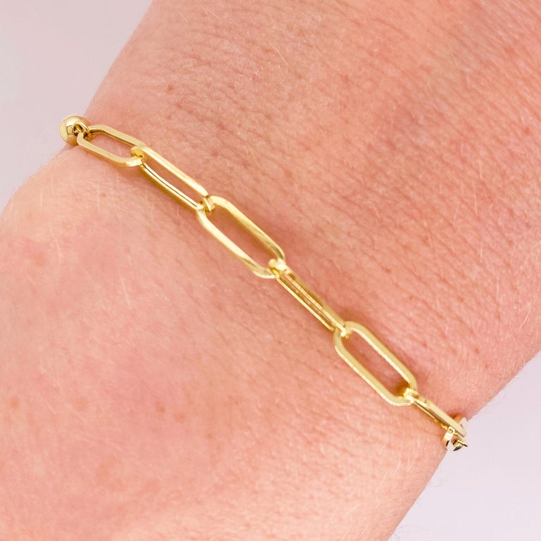 Paper clip chains are the hottest thing in 2020's jewelry fashion! This 14k yellow gold bracelet matches everything and is the perfect addition to any outfit, casual or formal. The bolo clasp on this bracelet allows you to wear it as snugly or