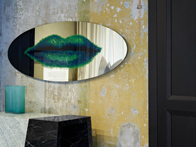 Labbra mirror, designed by Dino Gavina and manufactured by Paradiso Terrestre Material, features a silkscreened mirror with MDF frame. Dino Gavina met Man Ray in Paris. At the beginning the meeting was tense as Man Ray thought he was speaking to a
