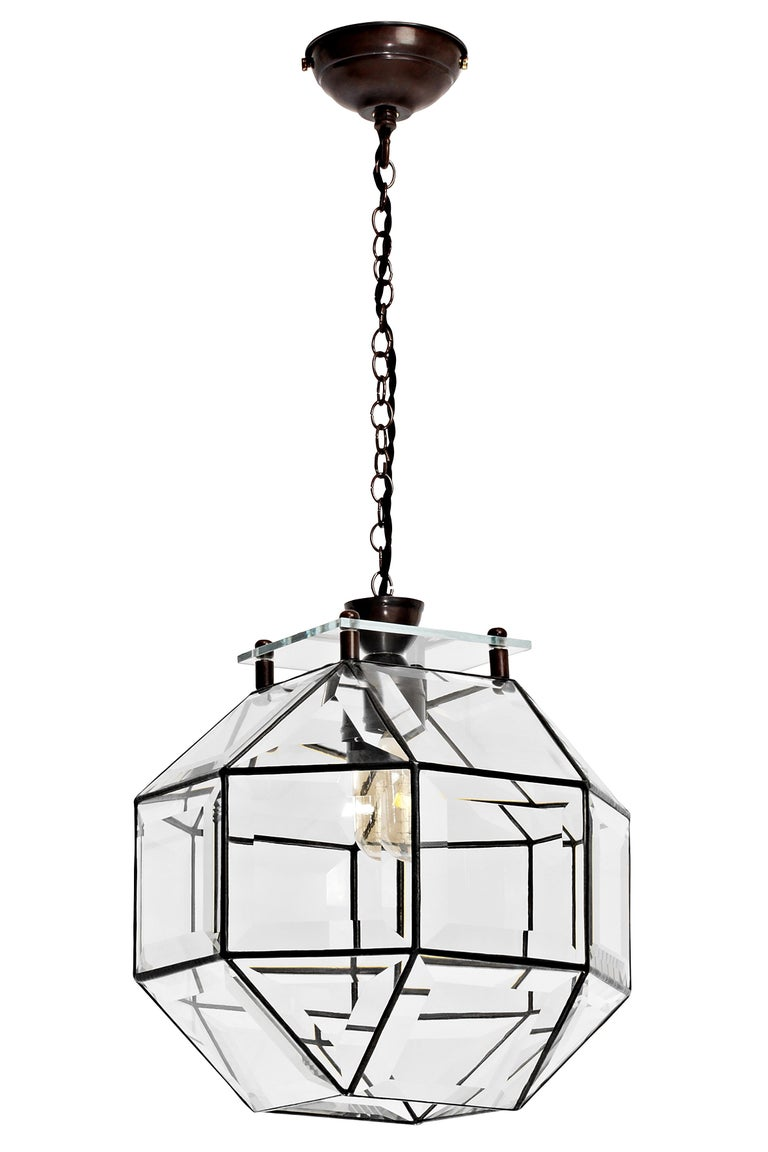 Paragon pendant by CTO Lighting Materials: bronze with bevelled glass and bronze oval chain Dimensions: H 30 x W 30 cm   All our lamps can be wired according to each country. If sold to the USA it will be wired for the USA for instance. Other