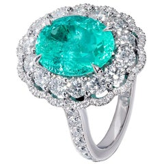3.82 carat Oval Paraiba Tourmaline and diamond Daisy Cluster Ring in 18 k White