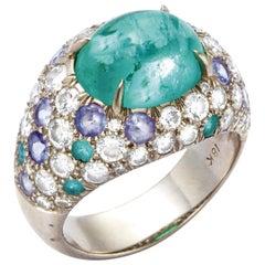 Paraiba Tourmaline, Diamond and Sapphire 18 Karat White Gold Ring