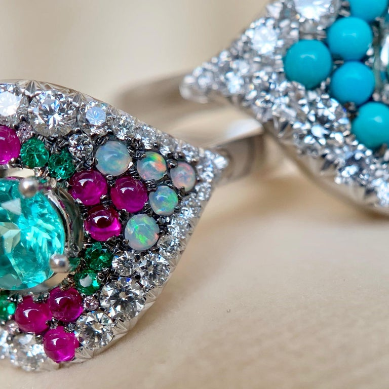 One of a kind ring handmade in Belgium from jewellery designer Joke Quick, in 18K White gold 9,1 g. Set with a Paraiba Tourmaline centerstone 0,39 Carat., pink Sapphire cabochons, Australian white opal, emerald 0,06 ct., White brilliant-cut diamonds