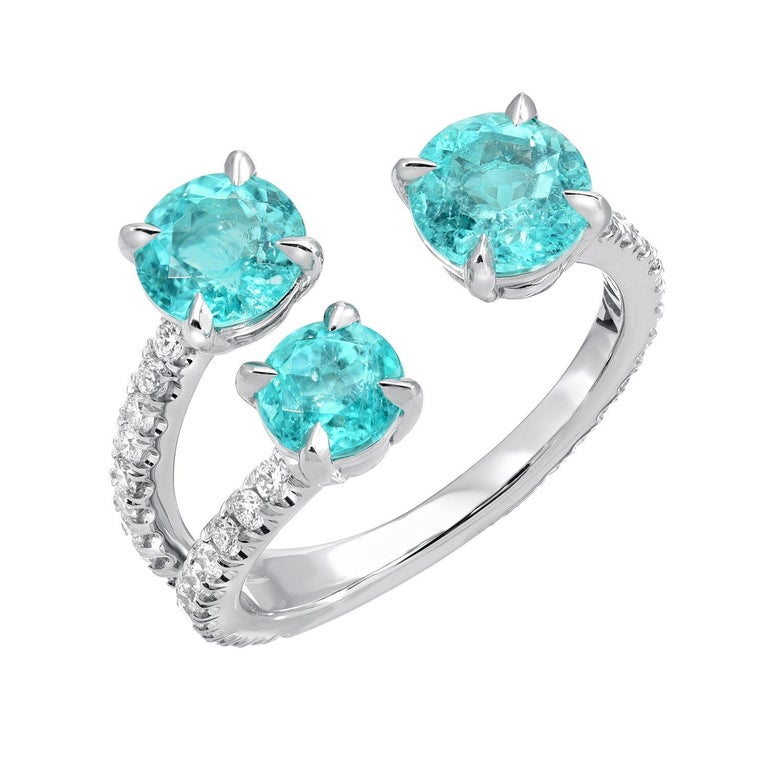 Immensely rare trio of Brazilian Paraiba Tourmalines, weighing a total of 2.09 carats, are hand set in this delicate and classy platinum cocktail ring, adorned by a total of 0.51 carats of round brilliant diamonds. AGL certificates are available for