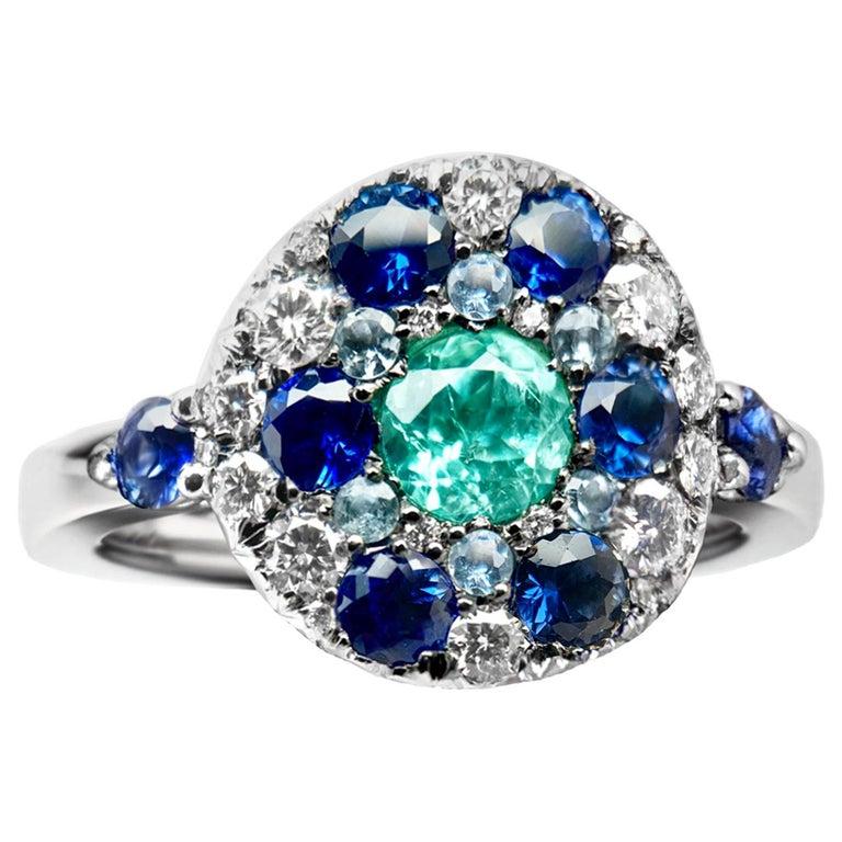 Paraiba Tourmaline, Royal Blue Sapphire, Aquamarine and White Diamond Ring For Sale