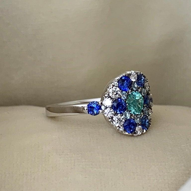 Art Nouveau Paraiba Tourmaline, Royal Blue Sapphire, Aquamarine and White Diamond Ring For Sale