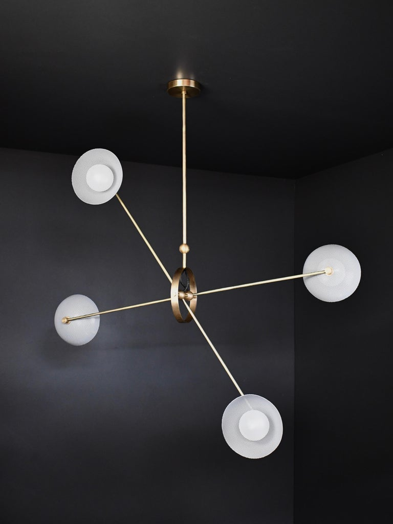 The Parallax ceiling fixture conveys a strong modern design defined by balance and equilibrium, a functional sculpture suspended in space. Parallax features four bowl-shaped shades fabricated of spun metal mesh ensconcing blown opal glass orbs.