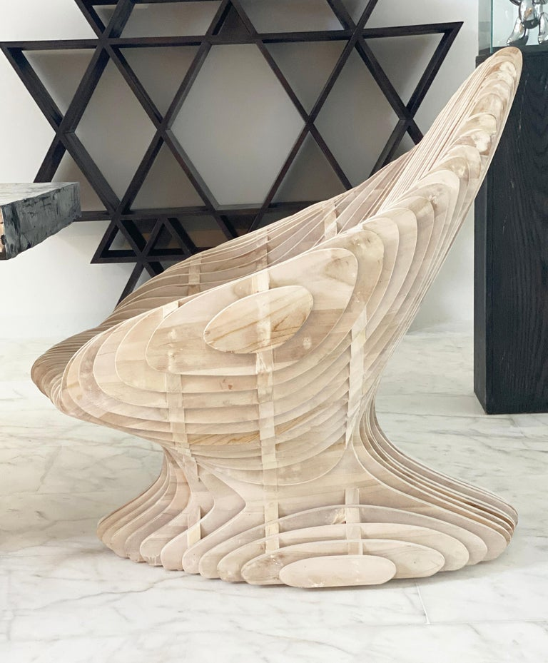 Limited edition parametric throne made of solid teak wood. Unlike most parametric furniture (which are machine-made), this piece is entire made by hand. Each chair is unique and has a more rustic, organic finish vs. machine-made pieces. This piece