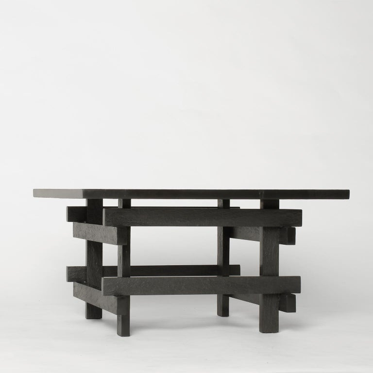 Coffee table entirely made of handcutted grey slate. This particular process characterizes the material with an irregular surface that reflects light in an unexpected way.  Every piece produced is signed and numbered. Customizable sizes and