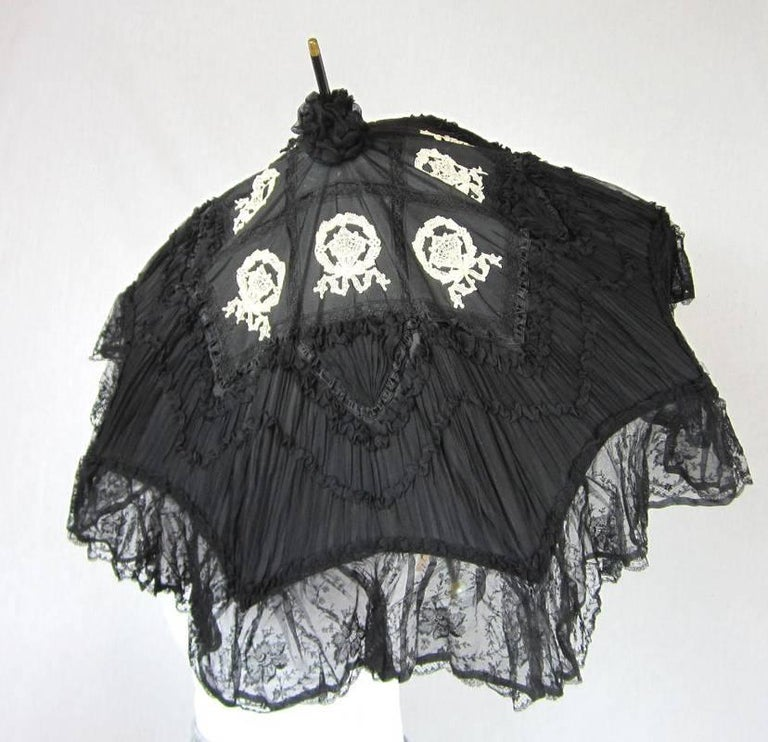 Victorian Black and white Parasol lace and silk, Provence 1900-1904 in original box No rips or damage...Stunning- I have never had one in this condition 4 inches of lace trim. Lovely enameled painted gold-flecked  ball at the end with Gold band with