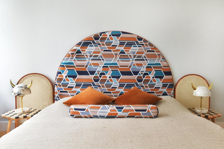 """""""Paravent Ideal"""" is a handcrafted, screen headboard made by artisans in Turkey, preserving and sustaining traditional Turkish handcrafts. The central large arc is upholstered in Maharam geometric fabric Agency, which has hues of burnt orange, blues"""