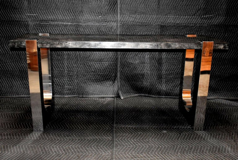Console table cover with goatskin and stainless steel legs. Parchment is in varying shades of dark charcoal. (High gloss polyester resin filled finish).