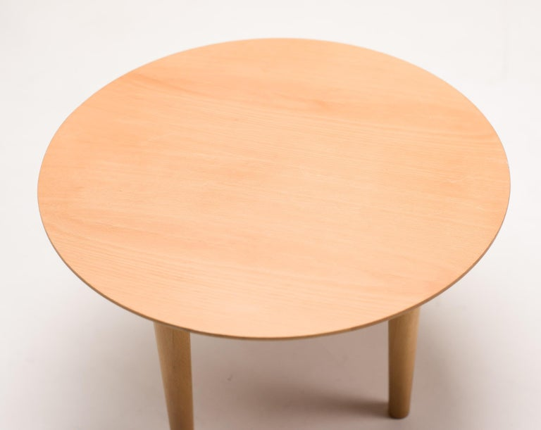 Elegant round solid beech coffee table by Spanish designer Lluis Clotet for Driade.  The Atlantide collection. Marked with label.