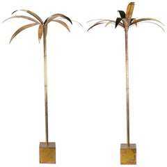 Pair of bronze golden french palm trees in a square base.