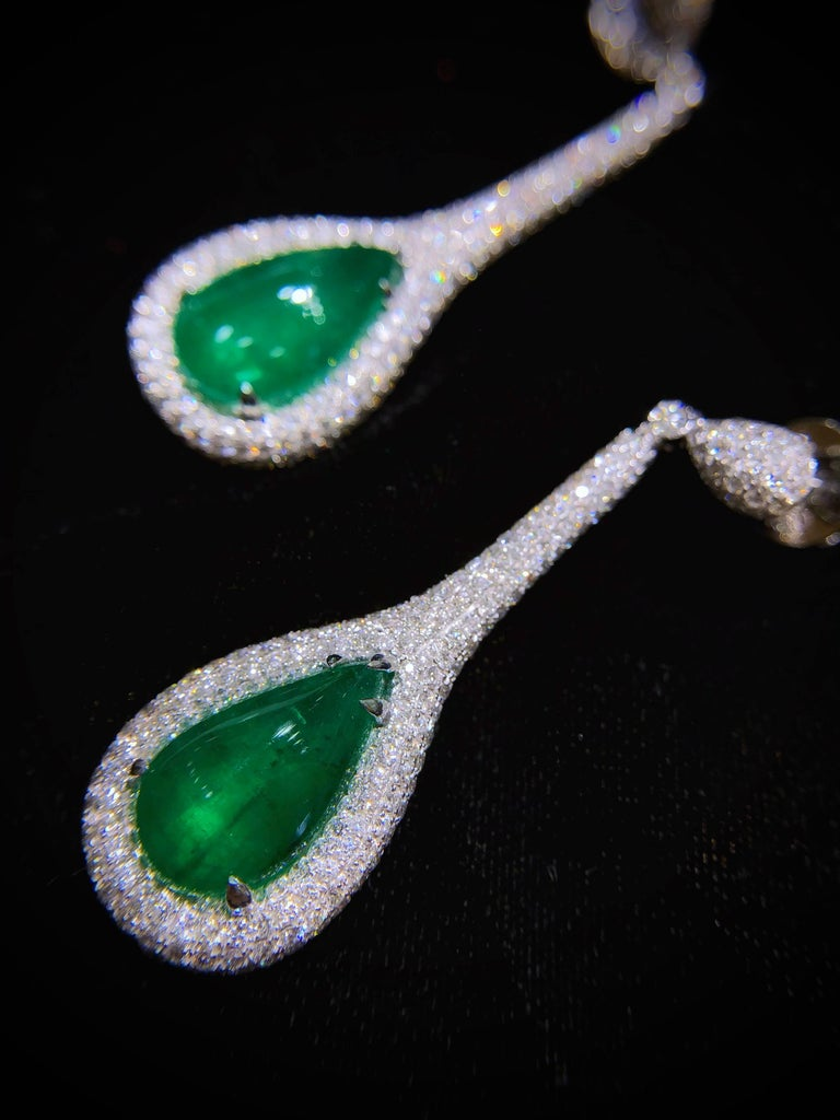 PARIS Craft House 11.48ct Emerald Diamond Earring in 18 Karat White Gold.  - 2 Teardrop Cabochon Emeralds/11.48ct - 498 Round Diamonds/3.94ct - 18K White Gold/12.38g  Designed and crafted at PARIS Craft House.